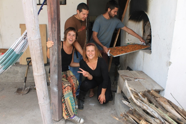 Making pizza in a brick-oven at Killa Wasi Hostel